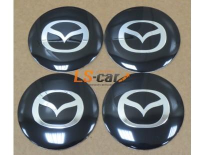 "Наклейка  OR-6 ""Mazda"" на автомоб, колпаки, диски (диаметр 65мм.) пластик/ комп. 4шт."